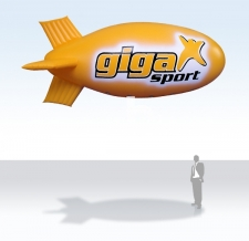Werbezeppelin fliegend - Giga Sport